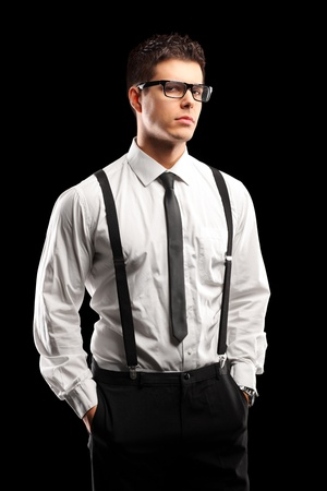 glasses model: A portrait of a stylish young man posing isolated on black background Stock Photo