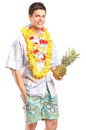 Portrait of a smiling man holding a pineapple isolated on white background photo