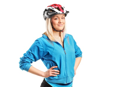 A smiling female athlete wearing helmet isolated on white background Stock Photo - 13166971