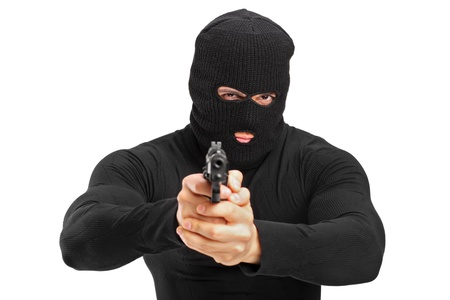 con man: Portrait of a thief holding a gun isolated against white background Stock Photo