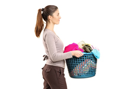 A portrait of a female holding a laundry basket isolated on white background photo