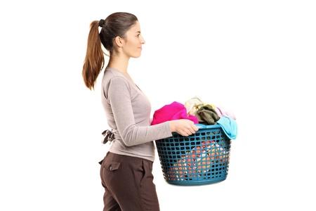 laundry basket: A portrait of a female holding a laundry basket isolated on white background