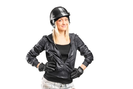 A portrait of a female motorcycler with helmet isolated on white background photo