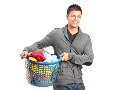 dirty clothes: A portrait of a man holding a laundry basket isolated on white background Stock Photo