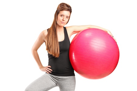 A portrait of a smiling female holding a fitness ball isolated on white background photo