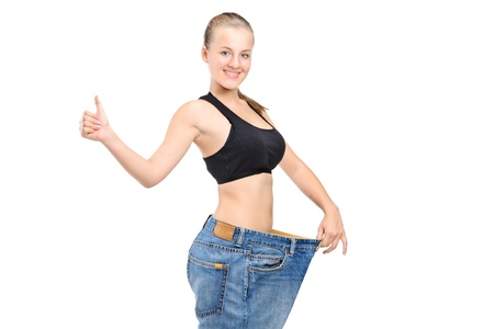 A portrait of a weightloss woman giving a thumb up isolated on white background photo
