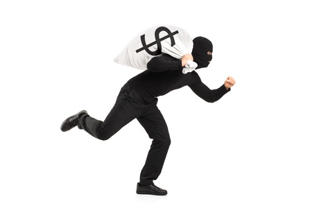 A thief carrying a bag and running away isolated against white background