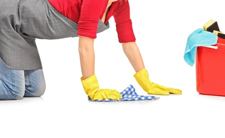 household objects equipment: Female cleaner wiping down and bucket with cleaning supplies isolated on white background