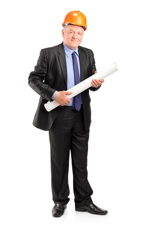 Full length portrait of a mature construction worker holding blueprints isolated on white background Stock Photo - 13525567