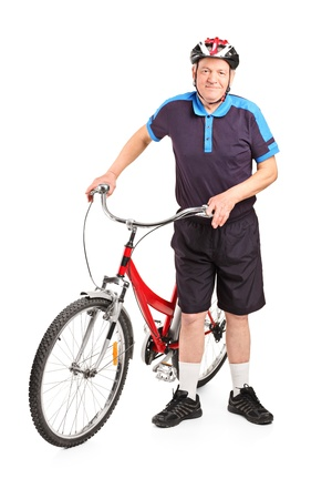 bicyclist: Full length portrait of a senior bicyclist posing next to a bicycle isolated on white background Stock Photo