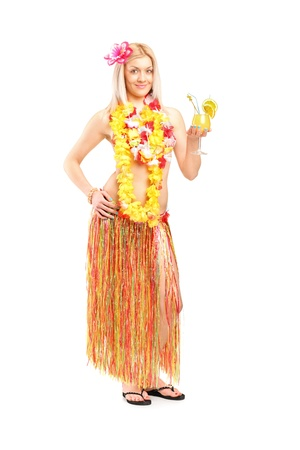 Full length portrait of an attractive young woman dressed in a hawaiian costume drinking cocktail isolated on white background photo