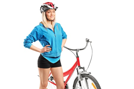 Female biker with helmet posing next to a bike isolated on white background Stock Photo - 13612847