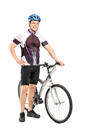 bicyclists: Full length portrait of a young bicyclist posing next to a bicycle isolated on white background
