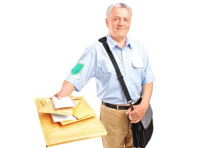 A smiling mature postman delivering letters isolated against white background