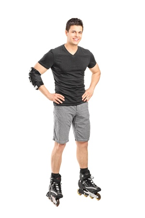 rollerblade: Full length portrait a male on rollers posing isolated on white background