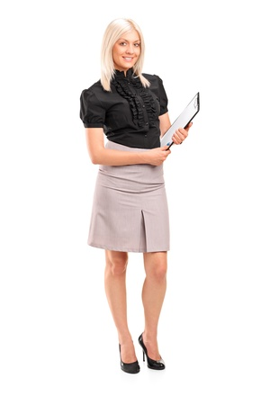 Full length portrait of a young businesswoman holding a clipboard isolated against white background photo