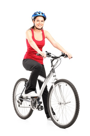 Female biker with helmet posing next to a bike isolated against white background Stock Photo - 13815974