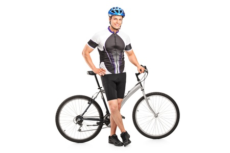 cyclist: Full length portrait of a smiling bicyclist posing next to a bicycle isolated against white background