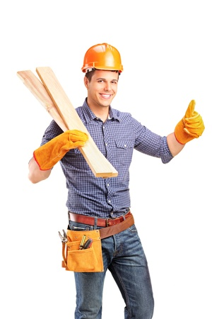 protective: A smiling female carpenter holding sills and giving thumb up isolated on white background