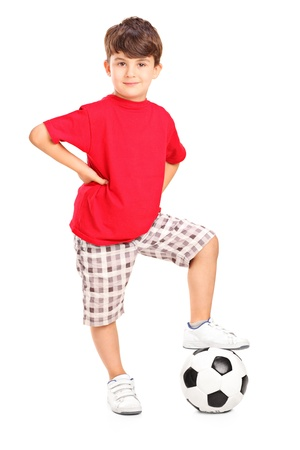 satisfied: Full length portrait of a boy posing with a soccer ball isolated on white background Stock Photo