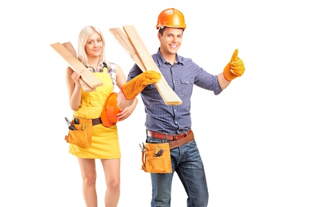 A smiling carpenter team of man and woman holding sills isolated on white background Stock Photo - 13991301