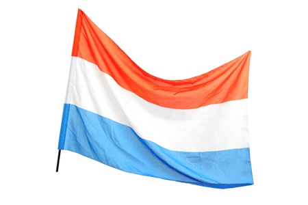 A studio shot of a dutch flag waving isolated on white background photo
