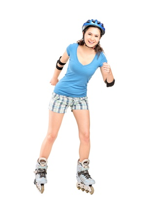 rollerskating: Full length portrait a girl on rollers skating isolated on white background Stock Photo