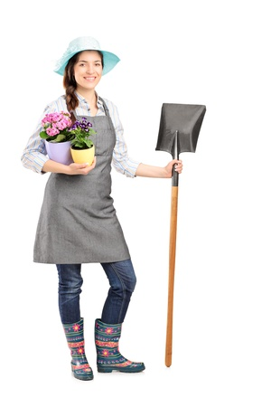 horticulturist: Full length portrait of a female worker holding a shovel isolated on white background Stock Photo