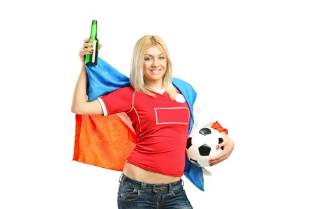Full length portrait of a happy female fan holding a beer bottle and football isolated on white background photo