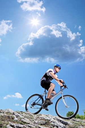 A view of a bicyclist riding a mountain bike downhill style photo