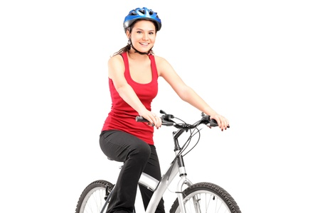 Female biker with helmet posing next to a bike isolated against white background Stock Photo - 14257237