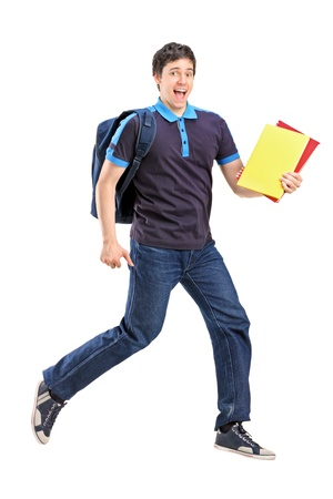 Full length portrait of a male student jumping with notebooks in his hand isolated on white background photo