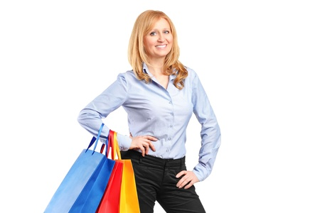 A smiling woman posing with shopping bags isolated against white background Stock Photo - 14286052
