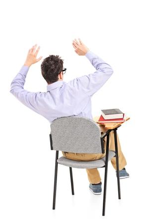 astonished: An afraid student sitting on a chair isolated on white background Stock Photo