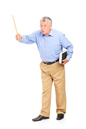 Full length portrait of an angry mature teacher holding a wand and gesturing isolated on white background photo