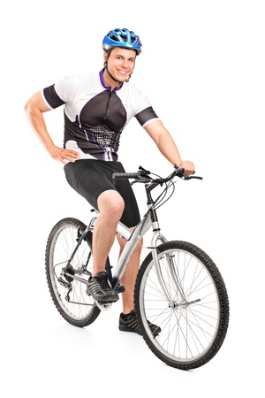Male biker with helmet posing on a bike isolated against white background Stock Photo - 14286214