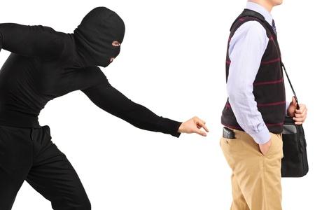 beroofd: Pickpocket het proberen om een portemonnee te stelen Stockfoto