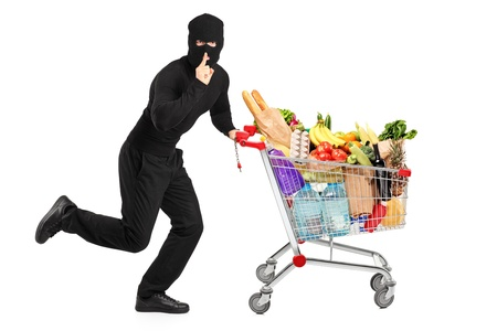 stealing: Robber stealing a pushcart with products, isolated on white background