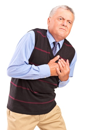 heart pain: Mature man having a heart attack, isolated on white background