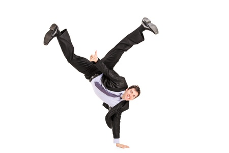 acrobatic: Businessman standing on one hand and giving a thumb up, isolated on white background Stock Photo