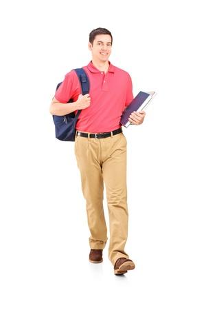 handsome student: Retrato de cuerpo entero de un estudiante de a pie, aisladas sobre fondo blanco