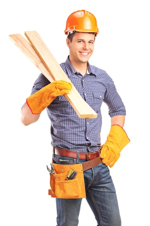 A smiling male carpenter holding sills isolated on white background photo