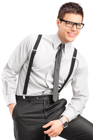 formal wear clothing: A young handsome male sitting on a chair isolated on white background