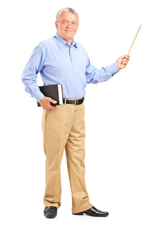 Full length portrait of a male teacher holding a wand and book isolated on white background Foto de archivo