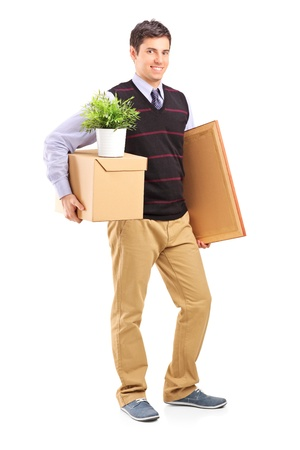 man carrying box: Full length portrait of a person with moving box and other stuff isolated on white