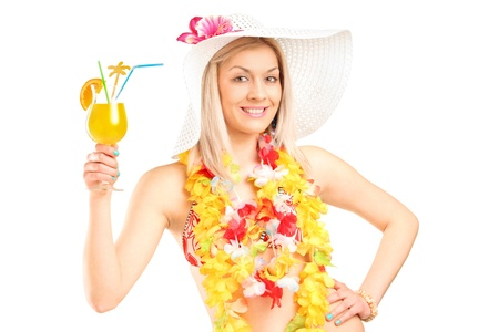 Portrait of a female dressed in a hawaiian costume holding an orange cocktail isolated on white  photo