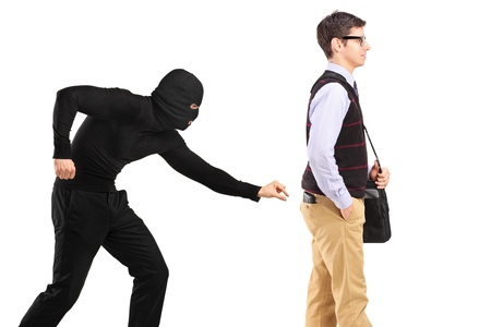 pickpocket: A pickpocket with mask trying to steal a wallet isolated on white background