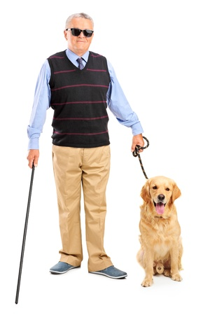a blind: Full length portrait of a blind person holding a walking stick and a dog isolated on white background Stock Photo