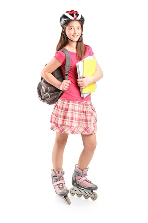 rollerblade: Full length portrait a girl on rollers holding notebooks isolated against white background