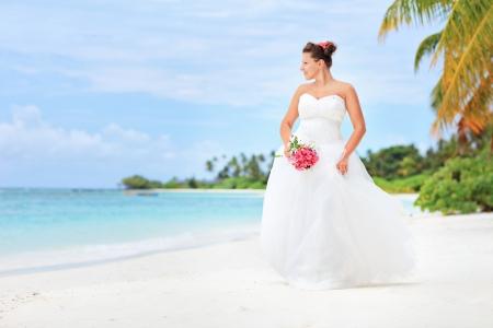 A bride posing on a beach in Kuredu resort, Maldives island, Lhaviyani atoll photo
